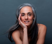 Image of happy, mature woman after transitioning to gray hair.